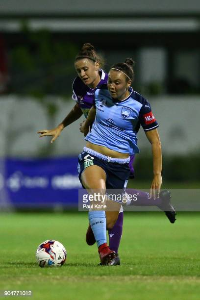 Natasha Rigby of the Perth Glory and Caitlin Foord of Sydney contest for the ball during the round 11 WLeague match between the Perth Glory and...
