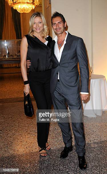 Natasha Stefanenko and her husband Luca Sabbioni attend Salvador Dali Opening Exhibition during Milan Fashion Week Womenswear S/S 2011 on September...