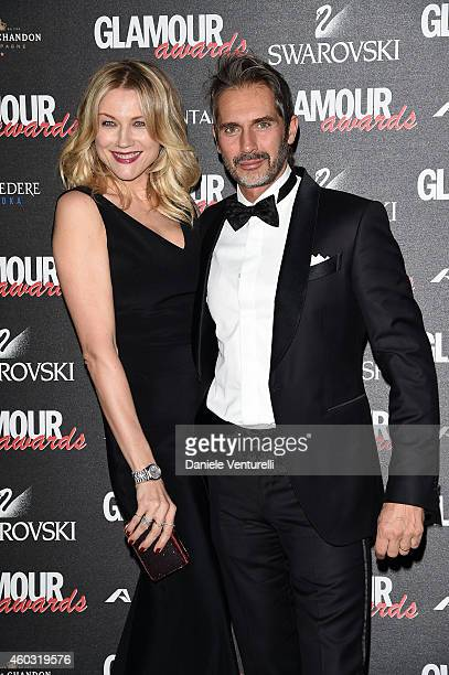 Natasha Stefanenko and Luca Sabbioni attend Glamour Awards 2014 on December 11 2014 in Milan Italy