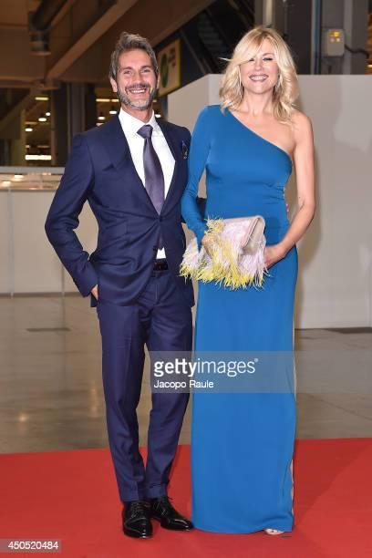 Natasha Stefanenko and Luca Sabbioni attend the Convivio 2014 on June 12 2014 in Milan Italy