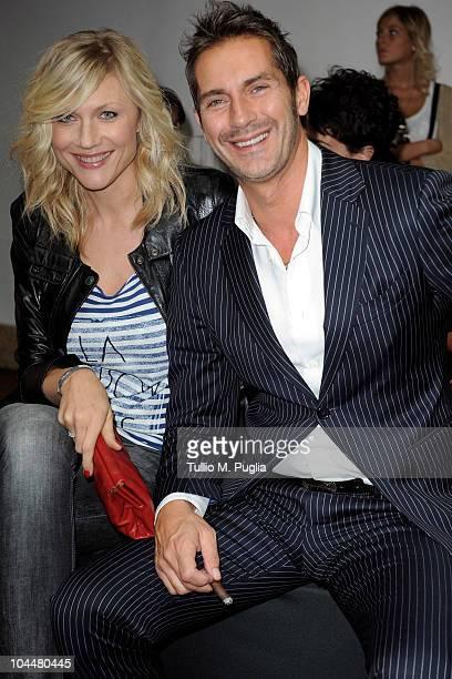 Natasha Stefanenko and Luca Sabbioni attend the Marco de Vincenzo Womenswear S/S 2011 show during Milan Fashion Week on September 26 2010 in Milan...