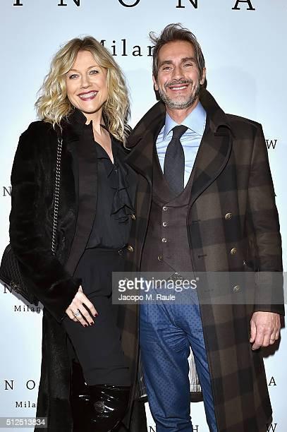 Natasha Stefanenko and Luca Sabbioni attend Winonah VIP Cocktail photocall during Milan Fashion Week Fall/Winter 2016/17 on February 26 2016 in Milan...