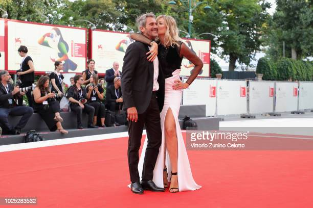 Natasha Stefanenko and Luca Sabbioni walk the red carpet ahead of the 'Roma' screening during the 75th Venice Film Festival at Sala Grande on August...