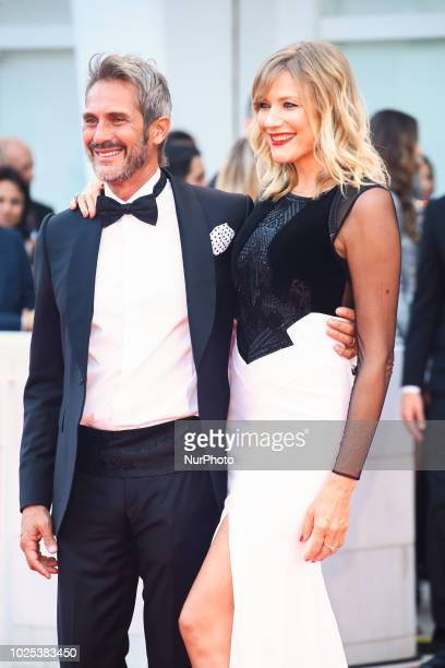 Natasha Stefanenko and Luca Sabbioni walks the red carpet ahead of the 'Roma' screening during the 75th Venice Film Festival in Venice Italy on...
