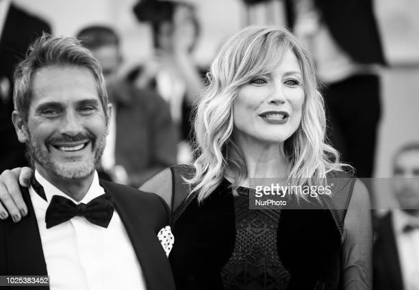Image has been converted to black and white Natasha Stefanenko and Luca Sabbioni walks the red carpet ahead of the 'Roma' screening during the 75th...