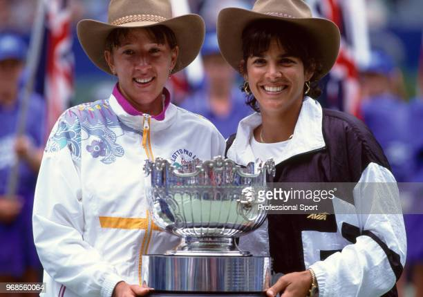 Natasha Zvereva of Belarus and Gigi Fernandez of the USA pose with the trophy after defeating Patty Fendick and Meredith McGrath both of the USA in...