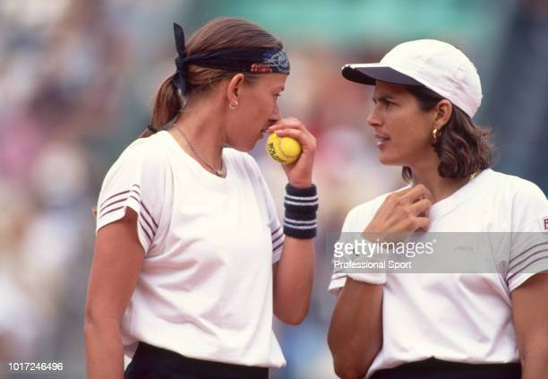 Natasha Zvereva of Belarus and Gigi Fernandez of the USA speaking during a Women's Doubles match in the French Open Tennis Championships at the Stade...