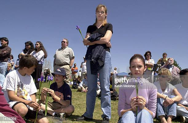Natashia Chacon right, her mother Stacy, center, and brothers Zachary, left, and Isaac sit with irises at a memorial service held on the anniversary...