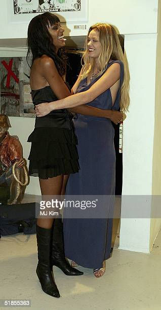 Natasja Vermeer and Judi Shekoni attend photocall for new film Private Moments after shooting movie scenes in Portobello Road on December 13 2004 in...