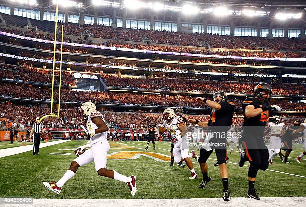 Nate Andrews of the Florida State Seminoles scores on an interception return against the Oklahoma State Cowboys in the first half of the Advocare...