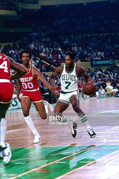 Nate Archibald of the Boston Celtics drives to the basket against Calvin Garrett of the Houston Rockets during a game played in 1982 at the Boston...