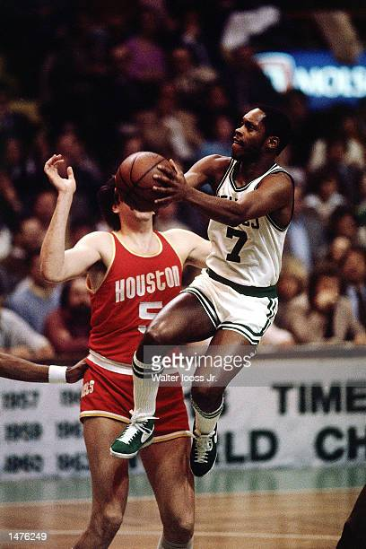 Nate Archibald of the Boston Celtics drives to the basket against the Houston Rockets at the Boston Garden in Boston Massachusetts NOTE TO USER User...