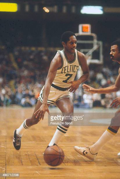 Nate Archibald of the Boston Celtics in dribbles the ball against the Golden State Warriors during an NBA basketball game circa 1979 at the Boston...