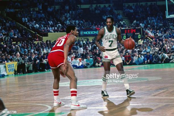 Nate Archibald of the Boston Celtics is being defended against Maurice Cheeks of the Philadelphia 76ers during a game played in 1981 at the Boston...