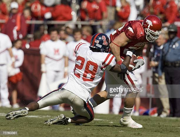Nate Banks of the Ole Miss Rebels makes a tackle during a game against the Arkansas Razorbacks at Reynolds Razorback Stadium on October 21, 2006 in...