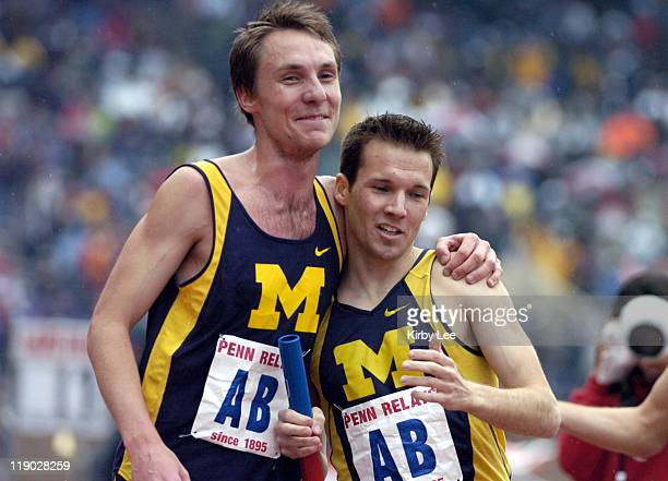 Nate Brannen of Michigan is congratulated by teammate Nick Willis after anchoring the Wolverines to a collegiate record of 160454 in the 4 x mile...