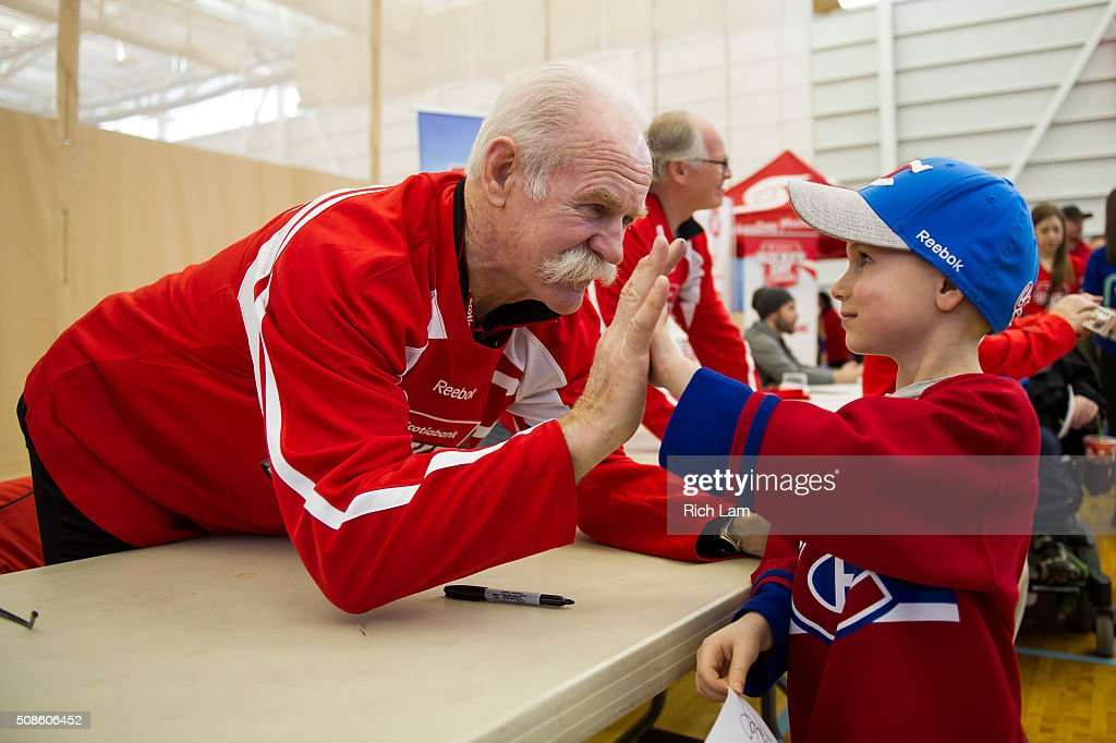Nate Brault give NHL Alumni Lanny McDonald a high-five during Day 2 of 2016 Scotiabank Hockey Day in Canada on February 5, 2016 in Kamloops, British Columbia, Canada.