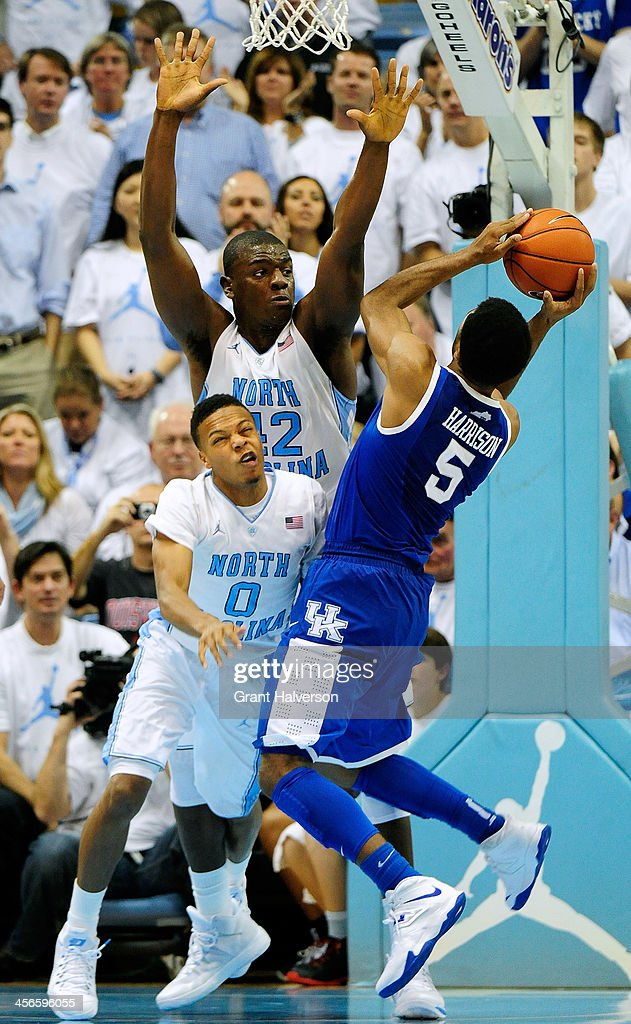Nate Britt #0 and Joel James #42 of the North Carolina Tar Heels defend a shot by Andrew Harrison #5 of the Kentucky Wildcats during play at the Dean Smith Center on December 14, 2013 in Chapel Hill, North Carolina. North Carolina won 82-77.