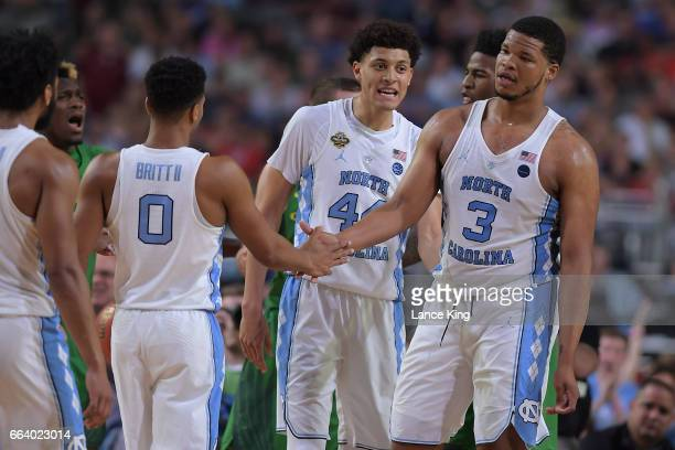 Nate Britt Justin Jackson and Kennedy Meeks of the North Carolina Tar Heels react following a play against the Oregon Ducks during the 2017 NCAA...