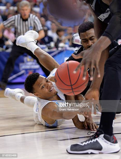 Nate Britt of the North Carolina Tar Heels batles for the ball against Kyron Cartwright of the Providence Friars in the second half during the second...