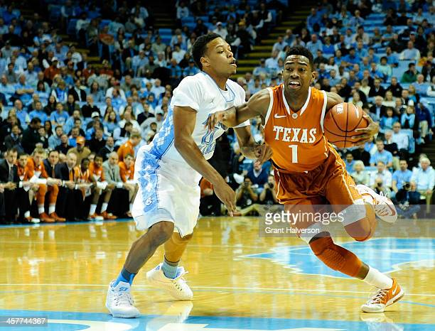 Nate Britt of the North Carolina Tar Heels defends a drive by Isaiah Taylor of the Texas Longhorns during their game at the Dean Smith Center on...