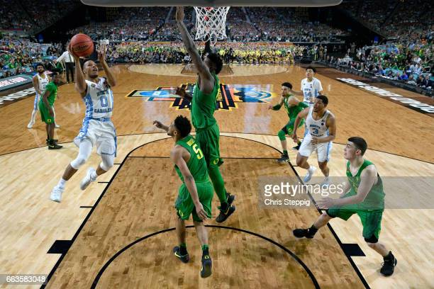 Nate Britt of the North Carolina Tar Heels goes in for a layup during the 2017 NCAA Photos via Getty Images Men's Final Four Semifinal against the...