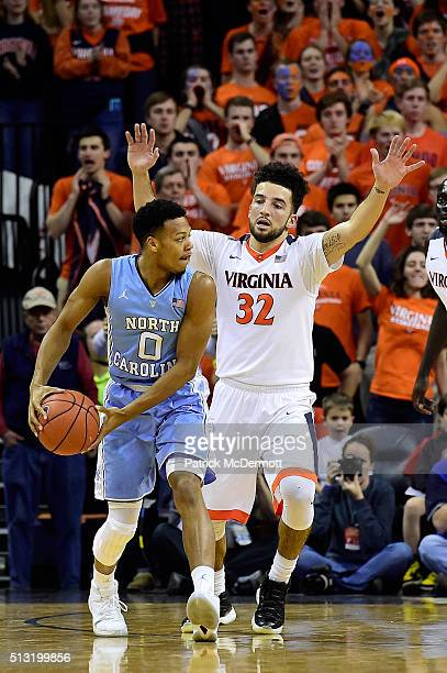 Nate Britt of the North Carolina Tar Heels handles the ball against London Perrantes of the Virginia Cavaliers in the second half during their game...