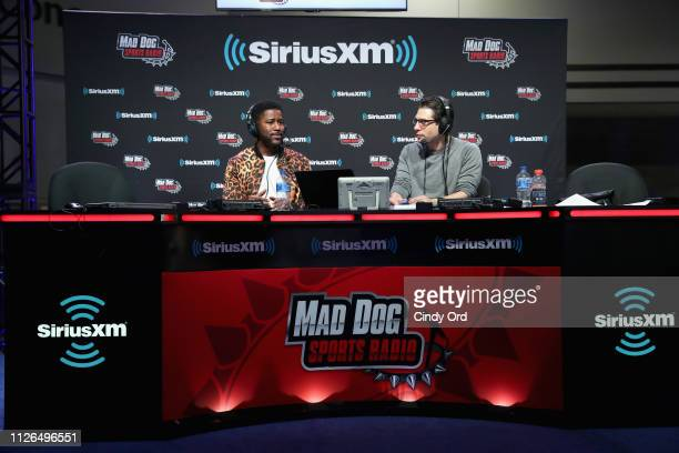 Nate Burleson and Adam Schein attend SiriusXM at Super Bowl LIII Radio Row on January 31 2019 in Atlanta Georgia