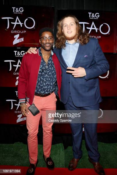 Nate Burleson and Storm Norton attend TAO group's Big Game Takeover presented by Tongue Groove on January 31 2019 in Atlanta Georgia