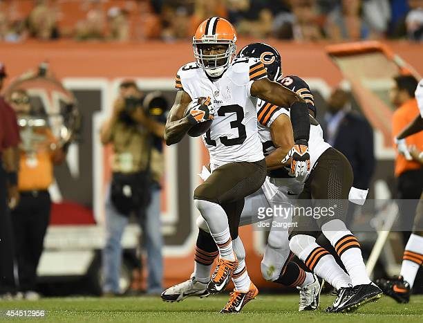 Nate Burleson of the Cleveland Browns carries the ball against the Chicago Bears at FirstEnergy Stadium on August 28 2014 in Cleveland Ohio