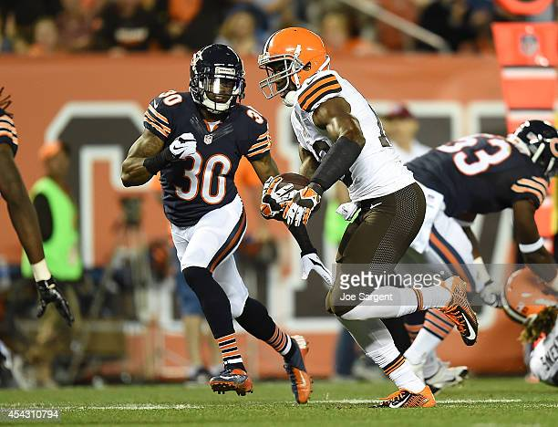Nate Burleson of the Cleveland Browns carries the ball in front of Demontre Hurst of the Chicago Bears during the second quarter at FirstEnergy...