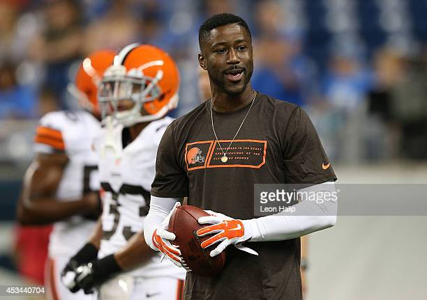 Nate Burleson of the Cleveland Browns watches the warms ups prior to the start of the preseason game against the Detroit Lions at Ford Field on...