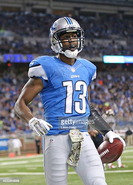 Nate Burleson of the Detroit Lions celebrates after scoring on a five yard pass during the second quarter of the game against the Tampa Bay...