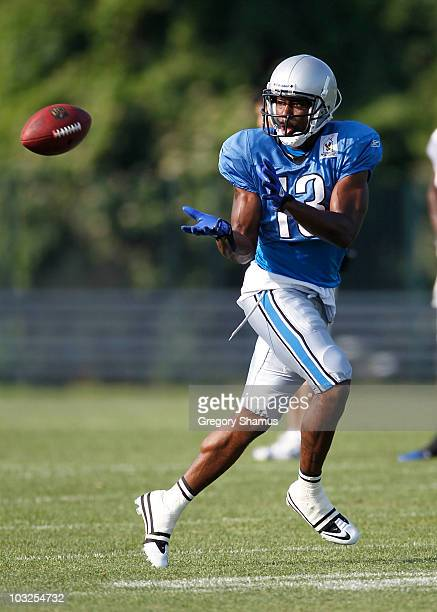 Nate Burleson of the Detroit Lions gets ready to catch a pass during training camp at the Detroit Lions Headquarters and Training Facility on August...