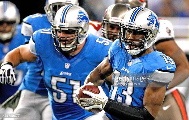 Nate Burleson of the Detroit Lions heads up field with teammate Dominic Raiola of the Detroit Lions against the Tampa Bay Buccaneers at Ford Field on...
