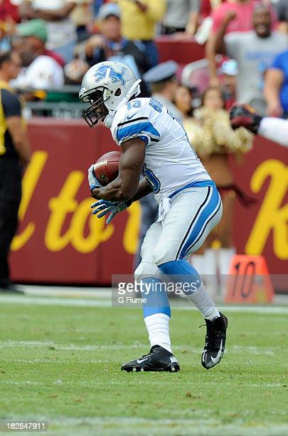 Nate Burleson of the Detroit Lions runs with the ball after a catch against the Washington Redskins at FedExField on September 22 2013 in Landover...