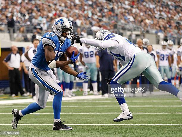 Nate Burleson of the Detroit Lions scores a late second quarter touchdown as Terence Newman of the Dallas Cowboys defends at Dallas Stadium on...