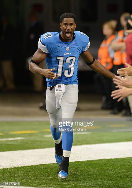 Nate Burleson of the Detroit Lions shakes hands with fans during player introductions prior to the game against the New York Jets at Ford Field on...
