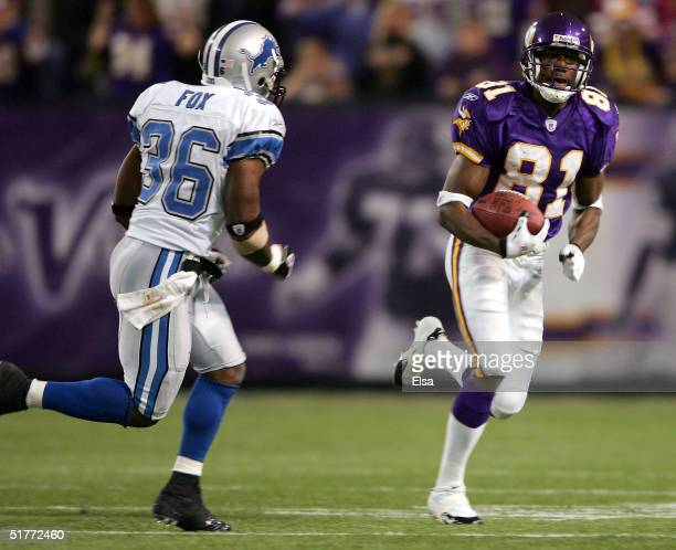 Nate Burleson of the Minnesota Vikings carries the ball as Vernon Fox the Detroit Lions defends on November 21 2004 at the Hubert H Humphrey...