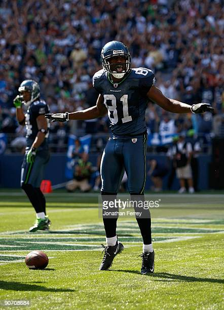 Nate Burleson of the Seattle Seahawks celebrates a touchdownl against the St Louis Rams at Qwest Field on September 13 2009 in Seattle Washington