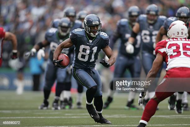 Nate Burleson of the Seattle Seahawks runs with the ball during a game against the Arizona Cardinals on December 9 2007 at the Centurylink Field...