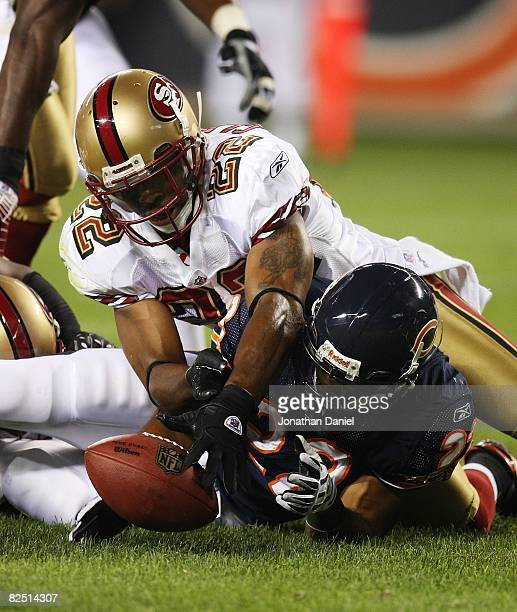 Nate Clements of the San Francisco 49ers and Matt Forte of the Chicago Bears battle for a loose ball on August 21 2008 at Soldier Field in Chicago...