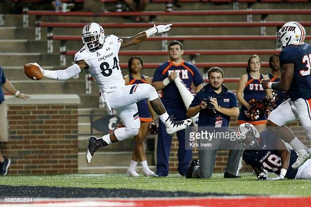Nate Cole of the Cincinnati Bearcats dives for the end zone but is pushed out of bounds by Kahlid Hagens of the Tennessee-Martin Skyhawks during the...