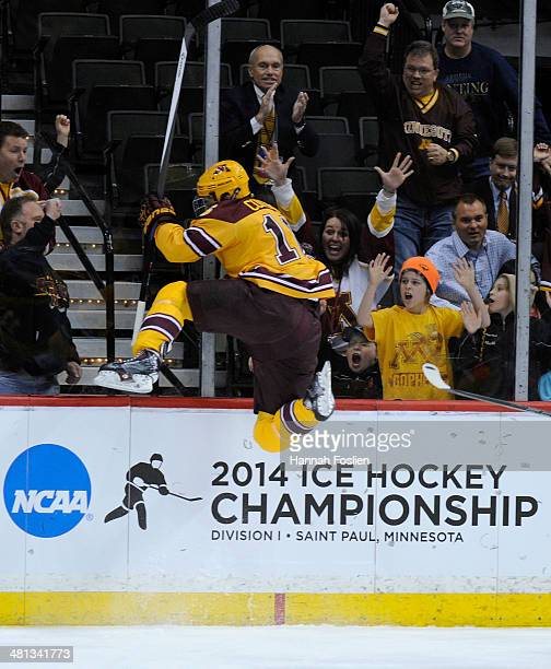 Nate Condon of the Minnesota Golden Gophers celebrates scoring a goal against the Robert Morris Colonials during the first period of the West...