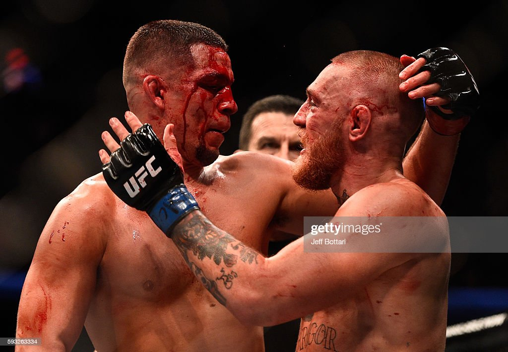 Nate Diaz and Conor McGregor of Ireland embrace after finishing five rounds in their welterweight bout during the UFC 202 event at T-Mobile Arena on August 20, 2016 in Las Vegas, Nevada.