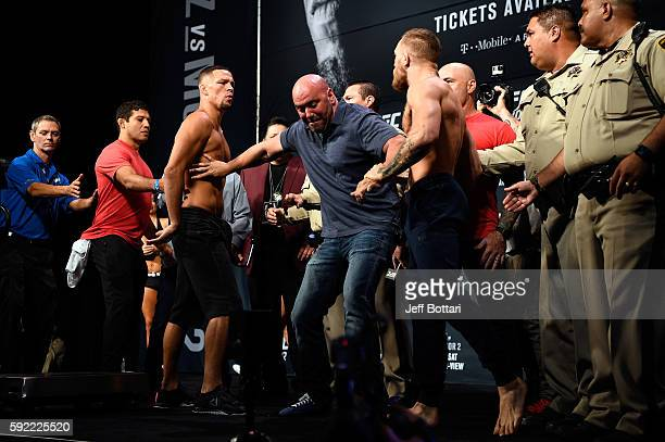 Nate Diaz and Conor McGregor of Ireland face off during the UFC 202 weigh-in at the MGM Grand Marquee Ballroom on August 19, 2016 in Las Vegas,...