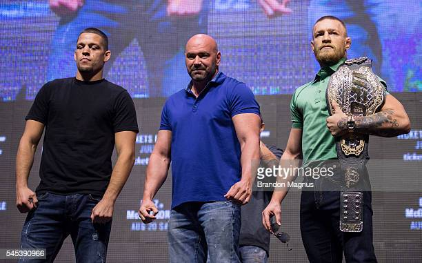 Nate Diaz and Conor McGregor pose for a picture during the UFC 202 Press Conference at TMobile Arena on July 7 2016 in Las Vegas Nevada