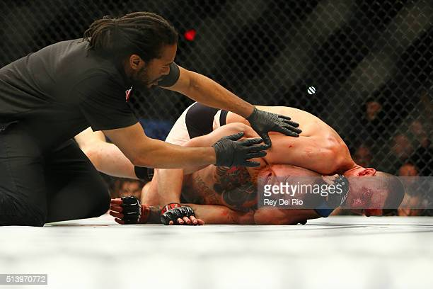 Nate Diaz applies a chokehold to win by submission against Conor McGregor during UFC 196 at the MGM Grand Garden Arena on March 5 2016 in Las Vegas...