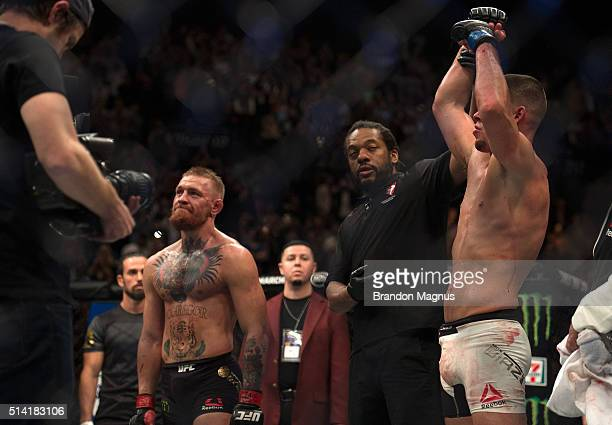 Nate Diaz celebrates his submission victory over Conor McGregor in their welterweight bout during the UFC 196 in the MGM Grand Garden Arena on March...