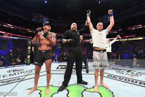 Nate Diaz celebrates his victory over Anthony Pettis in their welterweight bout during the UFC 241 event at the Honda Center on August 17, 2019 in...